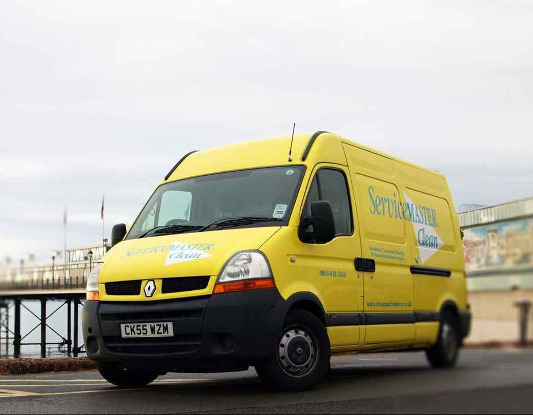Our distinctive Yellow ServiceMaster Clean Devon Van on paignton sea front. We serve customers across Devon, Torbay, Exeter and East Devon